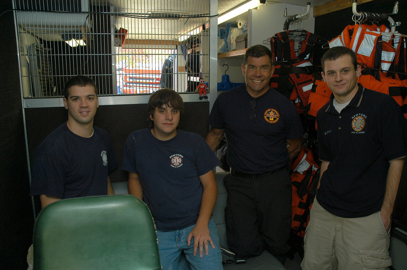 The Newtown Underwater Search And Rescue (NUSAR) van had some visitors. NUSAR Chief Mike McCarthy, second from right, explained NUSAR's operations to Newtown Hook & Ladder firefighters, from left, Dan Gindraux, Ricky Camejo, and Chris Gindraux.  (Gorosko photo)