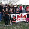 Newtown hosted its first full Light The Night event, a fundraiser for The Leukemia & Lym-phoma Society, on Saturday, September 25. The event took place on the grounds in front of Newtown Youth Academy and included live music, refreshments, LLS and related information, and a two-lap walk. Leading Team Nick with the honor of carrying the team's banner were, from left, Lucinda Fenix, Fernando Moreno, Adriana Moreno and Diana Rebelo.  (Hicks photo)