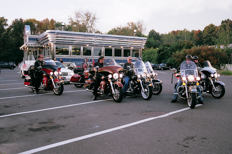 Escorted by members of the Danbury Harley Owners Group (HOG), the limousine provided by HOG left the Blue Colony Diner early Saturday morning, September 25, taking World War II veteran Darius Hallabeck to Bradley International Airport for a US Airways flight to Washington, D.C. Mr Hallabeck and 149 other veterans traveled to the nation's capital, thanks to a program sponsored by AmericanWarrior.  (Hallabeck photo)