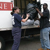 The 3rd Annual Newtown Volunteer Ambulance Corps Clothing Drive was held Saturday, September 25, at the ambulance garage at 77 Main Street. Area residents brought donations of clothing there, which were then packed into a box truck for transport to the Salvation Army Adult Rehabilitation Center in Bridgeport. Such donations are tax-deductible. Chelsea Fowler, left, of the ambulance corps helps Joe Jackson of The Salvation Army load some clothing items into the collection truck.  (Gorosko  photo)