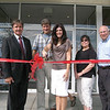 Joining together for the official ribbon cutting signaling the grand opening of Simply Baby and Kids were Selectman William Furrier, owners Carie and Richard Turk, along with local Economic Development commissioners Margaret Oliger and Ted Kreinick.  (Gorosko photo)