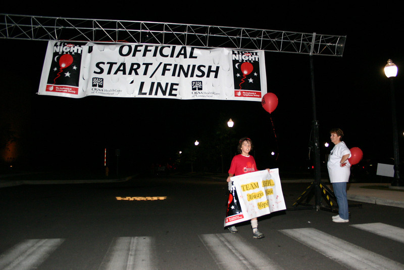 Aidan O'Leary carried banner for his team, Always Have Hope, but left his teammates behind when he saw the finish line approaching.  (Hicks photo)
