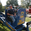 Jeff McKee, who is a Hawleyville volunteer firefighter, took a ride on The Convincer at the health fair. The device, which is operated by the state police, demonstrates to its riders the relatively strong force of a four-mile-per-hour impact, illustrating the importance of wearing seatbelts.   (Gorosko photo)