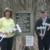 Josie and Bob Schmidt show off some of the new and renovated identification signs that will be placed along the trails at Orchard Hill Nature Center for the 4th Annual Town & Country Nature Walk. The event will return to the nature center, on Huntingtown Road near its intersection with Orchard Hill Road, on Sunday, May 15, from 2 to 5 pm. Organized by The Town & Country Garden Club of Newtown (which Mrs Schmidt is a member of), in cooperation with Newtown Parks & Recreation Department, Girl Scout Troop 599 and Newtown Lions Club (of which Mr Schmidt is a member), the event will encourage participants to explore the center's waterfall,  walk the boardwalk through ferns and wetlands, learn to identify wild flowers, plants and trees, and even answer some questions and qualify for prizes. Participants will receive a free plant or seed packet, and refreshments will be available. Contact Margareta Kotch at 203-426-5426 for additional information.  (Hicks photo)