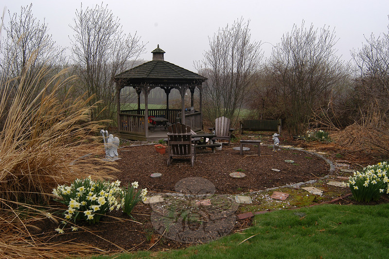 Merryhill Child Care Center's garden and gazebo before Laurelrock Landscaping of Wilton volunteers worked on the area on April 20, in honor of PLANET Day of Service.  (Hallabeck photo)