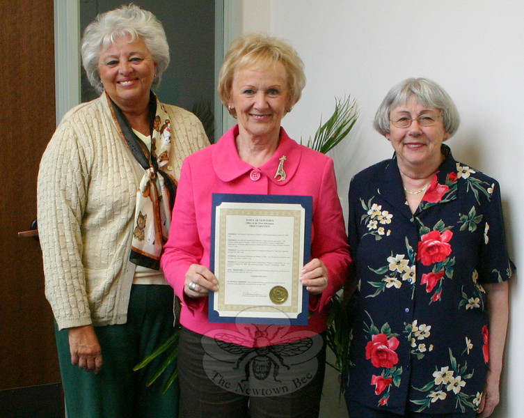The General Federation of Women's Clubs is an international women's organization dedicated to community improvement by enhancing the lives of others through volunteer service. GFWC was formed in 1890, and has since grown to become one of the world's largest woman's service organizations. Newtown Woman's Club, GFWC, was formed on March 25, 1968, making it one of the town's oldest continuously active service club. In honor of April 24 being observed as GFWC Federation Day, First Selectman Pat Llodra (center) recently presented a proclamation to Newtown Woman's Club co-vice president JoAnn Bruno and president Gladys McLaughlin. Ms Bruno's co-vice president, Nancy Kennedy, was unavailable to receive the proclamation, which was in part to honor the club's longevity and public projects.  (Hicks photo)