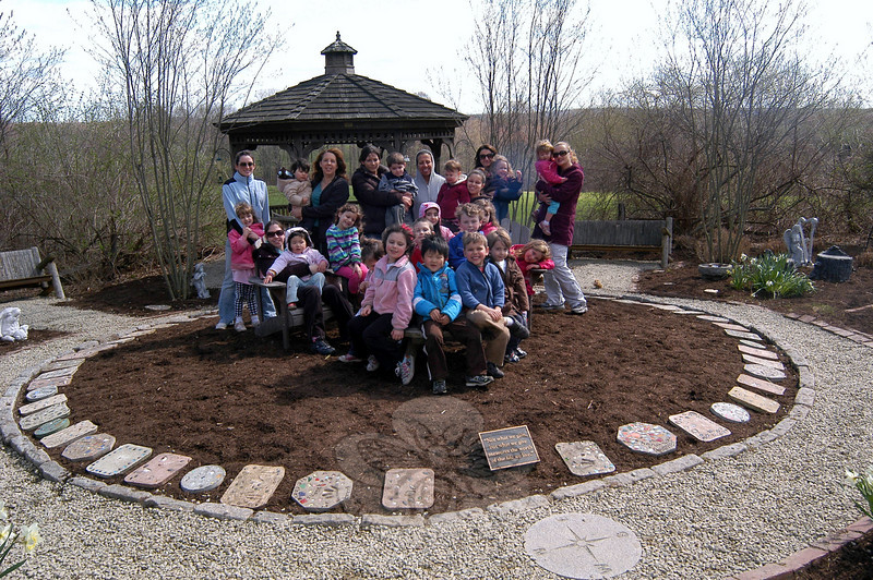 Merryhill Child Care Center, Inc, staff and students stood in the center's garden on April 21, the day after Laurelrock Landscaping of Wilton worked on the space.  (Hallabeck photo)