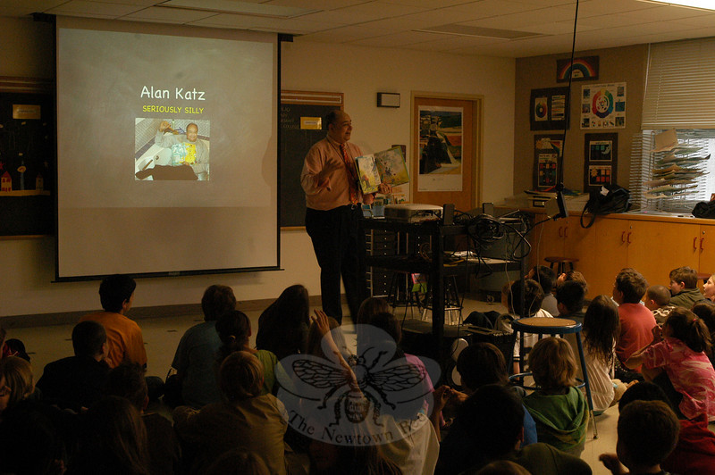 """Alan Katz, a children's book author, visited Middle Gate Elementary School on Tuesday, April 12, to speak to students during Middle Gate Loves To Read Week, a yearly weeklong celebration at the school. The event was sponsored by the school's PTA and overseen by Mary Blair. During his time at Middle Gate, Mr Katz also signed books and expressed support for the school's reading celebration. """"I just think it's fantastic,"""" said Mr Katz. """"I visit a lot of schools, and this school is revved up for reading.""""  (Hallabeck photo)"""