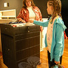 "Head O' Meadow fourth grader Kiera Sughrue, right, turns in her ballot for the school's ""Vote for Books"" campaign on Monday, April 25, under the guidance of Newtown Democratic Registrar of Voters LeReine Frampton.  (Hallabeck photo)"