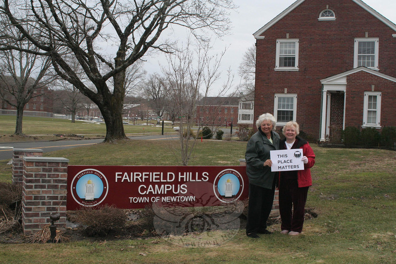 "Newtown Woman's Club, GFWC, Inc is continuing its ""This Place Matters"" series with a look this month at Fairfield Hills, an area of more than 700 acres just northeast of the geographic center of town. The former home of a major psychiatric hospital that operated from June 1933 until December 1995, the Town of Newtown purchased about 190 acres of the property from the State of Connecticut in 2004. The former Bridgeport Hall has been renovated into Newtown Municipal Center, and Fairfield Hills has become home to town offices including the first selectman, town clerk, tax collector, tax assessor, finance director, community development director, registrars of voters, Board of Education, and others. The land surrounding the office buildings and Newtown Youth Academy is also home to at least four ball fields, trails, and acres of open space. Fairfield Hills has also been the home of Newtown's Relay For Life for the past two years, and will again host the American Cancer Society fundraiser this June. Woman's Club members and JoAnn Bruno, left, and Anna Wiedemann, are seen near the main entrance to the Fairfield Hills campus, at the intersection of Wasserman Way and Primrose Street.  (Hicks photo)"