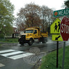 A town highway department truck travels westward on Glover Avenue, near Meadow Road, on a rainy Wednesday morning. A work crew had started repainting worn crosswalk markings on Glover Avenue there that morning, but then it started raining, requiring that crew members continue the project when the road becomes dry enough for the work.  (Gorosko photo)