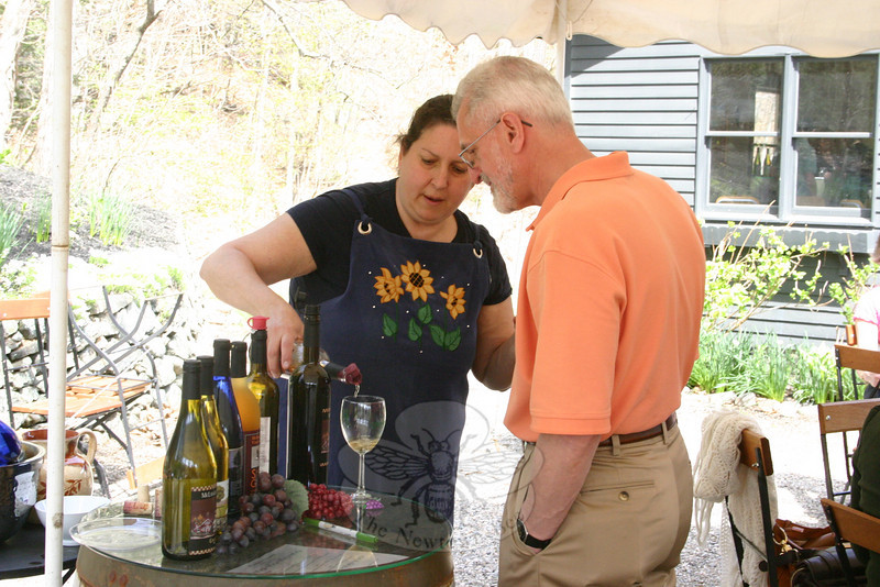 Patricia Sabato, a friend of McLaughlin Vineyard, poured the wine and answered questions asked of guests during the LLS wine tasting/fundraiser at the vineyard on May 1.  (Hicks photo)
