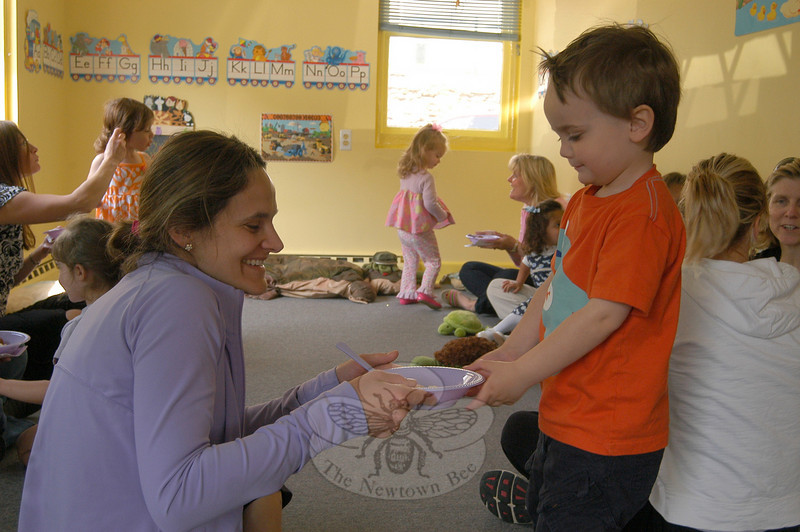 During a Mother's Day celebration held on Tuesday, May 3, at Mr Turtle's School in Sandy Hook, students treated their moms to an ice cream snack. Ryan Whalen, right, handed his mother, Karen Whalen, ice cream during the event.  (Hallabeck photo)