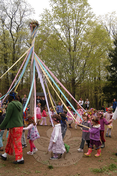 Housatonic Valley Waldorf School carried on the traditions of Maypole and Morris & Sword dances by weaving Maypole ribbon patterns and performing stick and sword dances during the school's 20th Annual May Fair, held Monday, May 2. Above, students dance around the Maypole with teachers.   (Hallabeck photo)