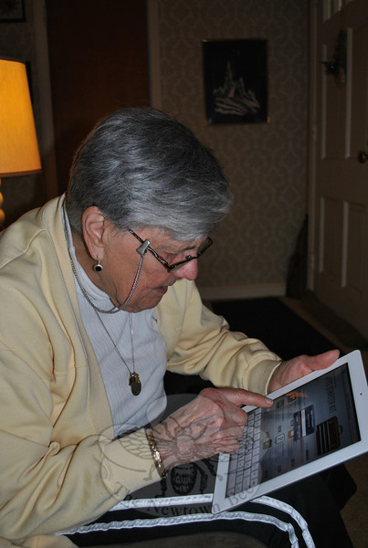 Ilse Foster pokes around on her iPad 2, at home, as she masters the new technology. Taking on the challenge is good for her brain, and a real thrill, she says.  (Crevier photo)