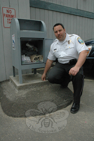 Police Lieutenant Christopher Vanghele reveals the contents of the prescription drug disposal box outside the police station on April 30. The US Drug Enforcement Administration (DEA) later picked up those drugs and other unwanted prescription drugs which police collected that day for proper disposal.  (Gorosko photo)