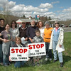 Some opponents of a cellular telecommunications tower that has been proposed for a site behind Dodgingtown Garage at 61 Dodgingtown Road (Route 302) staged a quiet protest against the project across the street from the garage on Saturday, April 30. Pictured, from left, are William Hine, Christine Hine, Sylvianne Carbone, Holly Kocet, Joe Kocet, Fred Baumer, Michael Carbone, Robin Hickson, Diane Baumer, and Joan Rothfuss.  (Gorosko photo)