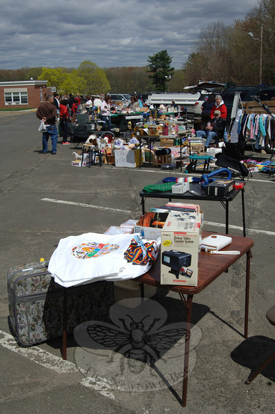 "The Woman's Club GFWC held its inaugural Clear The Clutter tag sale and fundraiser, which filled the length of Newtown Middle School's side parking lot Saturday, April 30. JoAnn Bruno noted that the sale's proceeds ""go to our philanthropy.""  (Bobowick photo)"