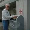 Hank Kessler of Sandy Hook deposits some unwanted prescription drugs in a drug disposal box positioned outside the police station at 3 Main Street on Saturday, April 30. The public had an opportunity to properly dispose of potentially dangerous, expired, unused, and unwanted prescription drugs.  (Gorosko photo)