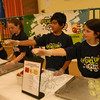 Reed Intermediate School Student Council members Talia Hankin, right, and Abir Singh handed out honeydew melons to students during the school's Fuel Up To Play 60 taste testing event on Thursday, April 28.  (Hallabeck photo)