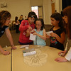 "IBM program manager Tricia Johnson oversees Hawley third graders, from right, Kiera O'Sullivan, Sophia Romano, Aniko Walsh, and Tanyon Estores while the group assembles a windmill out of given ""everyday"" objects.  (Hallabeck photo)"