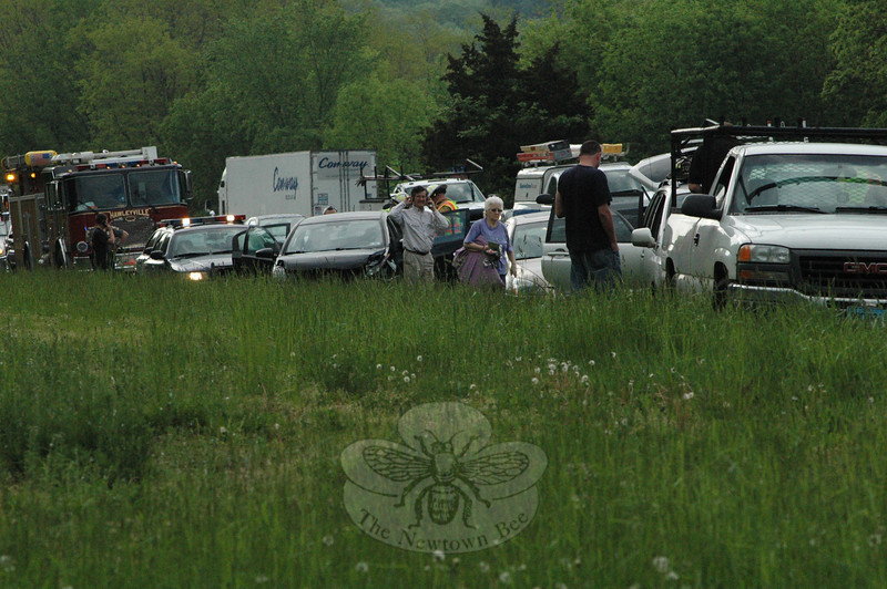 Two accidents involving five vehicles on eastbound Interstate 84 occurred about 3:30 pm on May 20 in the area between the highway's Exit 9 off-ramp and on-ramp, causing travel delays at the start of the Friday evening rush period. The incident involved eight people, including five drivers and three passengers, state police said. Two passengers complained of pain and were transported to Danbury Hospital where they were evaluated and later released. In the first accident, a Toyota stopped for traffic conditions, after which a Nissan stopped behind the Toyota. A GMC then struck the Nissan, pushing the Nissan into the Toyota. Another GMC was able to stop before becoming involved in the three-vehicle collision, but it was then struck by a Honda. State police issued the driver of the GMC which caused the first accident an infraction for traveling too fast for conditions and for operating an unregistered vehicle. Hawleyville firefighters responded to the incident.  (Gorosko photo)