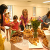 "Mothers and significant female role models were welcomed at Middle Gate Elementary School during the PTA's Muffins with Mom two-day event. Muffins and other baked goods, along with drinks, were offered to visitors in the school's cafeteria before school on both Thursday, May 12, and Friday, May 13. The school's PTA also sponsors a pancake breakfast with dads in the fall of each school year. Above, students and their ""moms"" pick out morning snacks from a table on Friday.  (Hallabeck photo)"