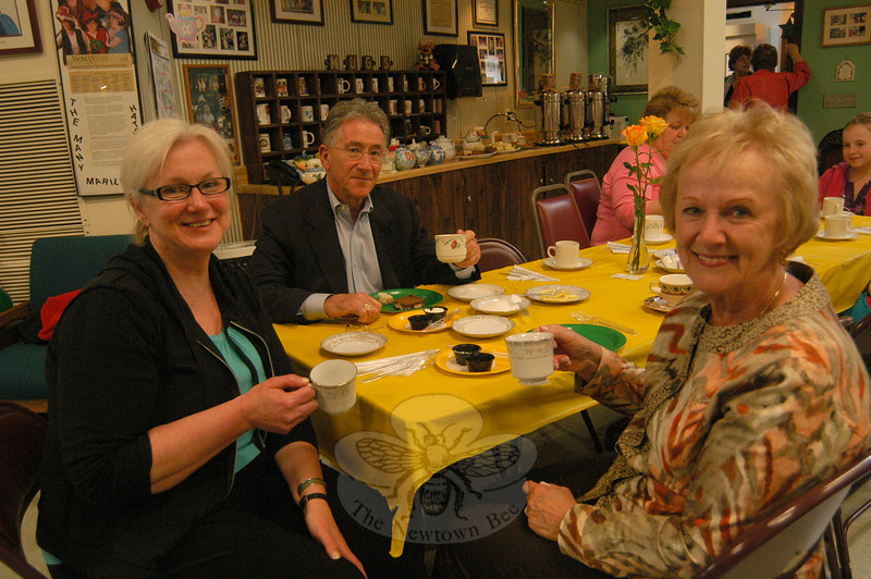 A Victorian Tea fundraiser was held at the Newtown Senior Center on Sunday, May 15, to raise funds toward the purchase a new handicapped accessible bus for the center. Simpson & Vail teas, scones, finger sandwiches, and more baked goods, prepared by volunteers, were offered during the event. Enjoying their tea, from left, Terry Laslo, Bob Llodra, and First Selectman Pat Llodra.  (Hallabeck photo)