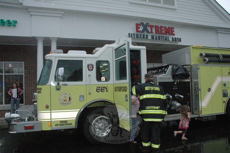 Children at Extreme Fitness Martial Arts were able to get a close look at a Botsford fire truck when Botsford firefighters participated in a public safety day program there on May 21.  (Gorosko photo)