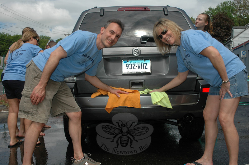 Mike and Diane McCabe along with about a dozen other volunteers held a car wash fundraiser May 21 at Berkshire Motors in Sandy Hook. The McCabes are members of the Relay For Life We Are Family team, which is one of the many teams independently raising money for the 2011 relay event June 4-5 at Fairfield Hills.  (Gorosko photo)