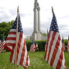 The Soldiers and Sailors Monument, representing liberty and peace, stands in recognition of local veterans; it is Newtown's enduring tribute to those who have served to protect the nation in the armed forces. This week, American flags surrounded the base of the monument, placed there by members of Newtown Woman's Club, GFWC in time for the Memorial Day weekend.  (Bobowick photo)