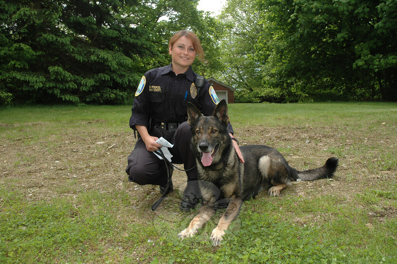 Newtown Police K-9 Officer Felicia Figol is shown with Baro, the police department's German shepherd, at the 2nd annual Strutt Your Mutt fundraising event. Police demonstrated Baro's skills at the May 21 gathering at Fairfield Hills.  (Gorosko photo)