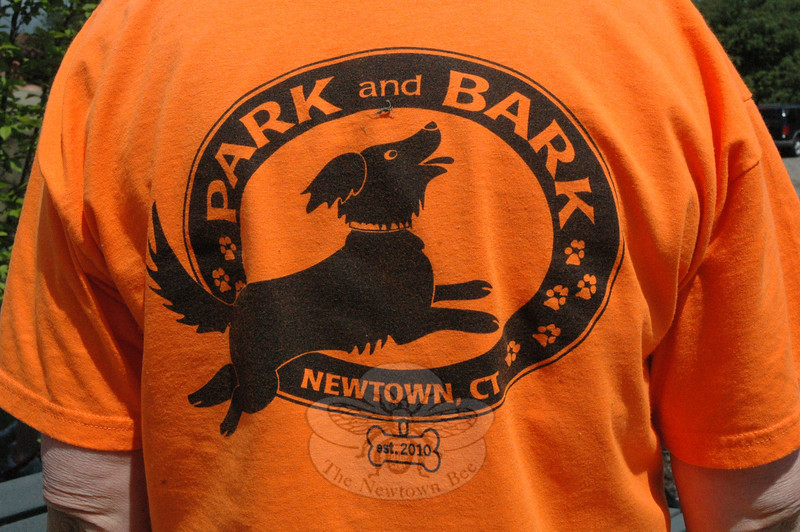 As the graphic on this shirt displays, the Strutt Your Mutt event was held as a fundraiser for Newtown's future dog park.  (Gorosko photo)