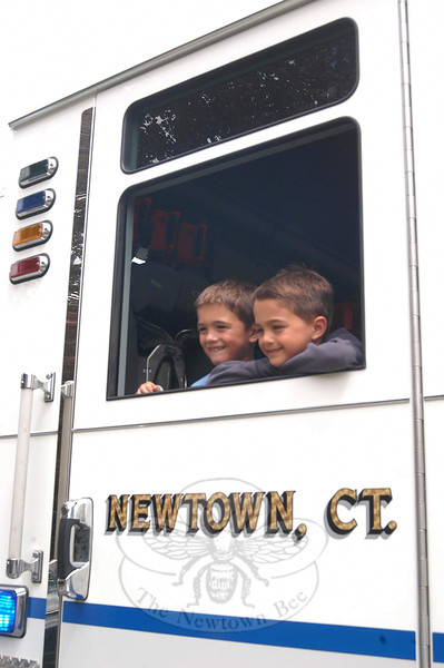 "St Rose of Lima preschoolers Daniel, left, and twin brother Luke Kellerman arrived at school on Wednesday, May 11, in time to be greeted by their fellow students. Daniel and Luke had been driven to school by Dodgingtown Volunteer Fire Company Captain Joe Masso and firefighter Matt Luciano. Daniel and Luke's mother, Crissy, earned the ride for her sons during an auction at Head O' Meadow school. The boys chose their grandfather, ""Papa"" Bill Yantorno, as their accompanying chaperone.  (Hallabeck photo)"
