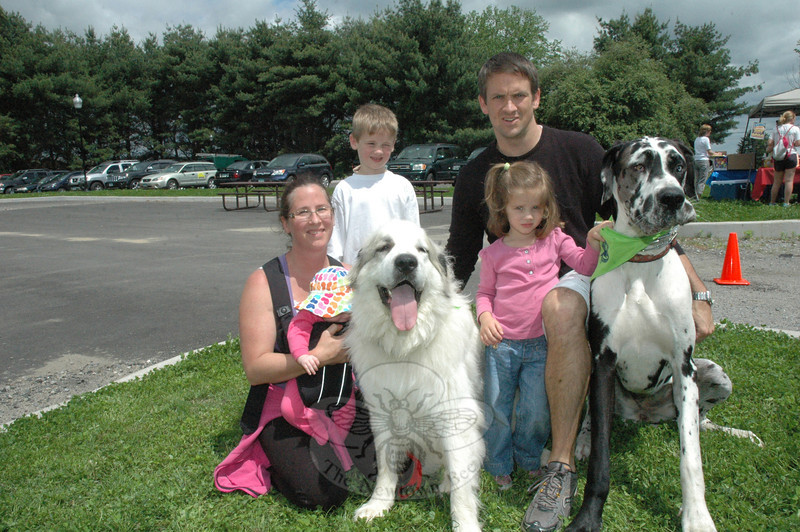 Members of the Walder family of Sandy Hook were among the many people who attended the second annual Strutt Your Mutt event held on May 21 at Fairfield Hills. The event benefits the future Newtown dog park. Parents Kevin and Anne Walder brought their children, from left, Payton, Hayden, and Isabella, as well as their Great Pyrenees known as Sugar and their Great Dane known as Ginger to the festive event.  (Gorosko photo)