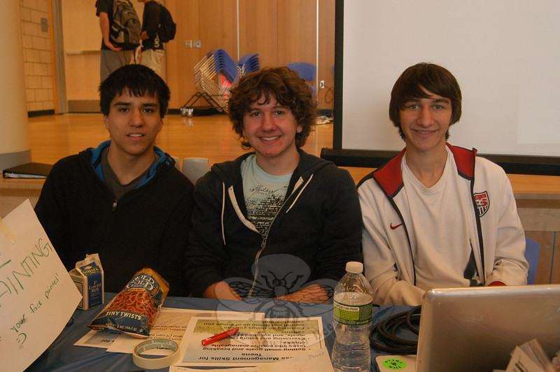 Newtown High School students, from left, Charlie Bronson, Scott Buchanan, and Mergim Bajraliu oversaw a booth created by their health science class on teen stress at the health fair.  (Hallabeck photo)
