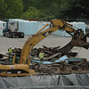 Workers used heavy equipment this week for a demolition project at the BlueLinx Corporation's building materials storage depot at 201 South Main Street. Last February, under the weight of accumulated snow, a large warehouse and two large storage sheds collapsed at the site. BlueLinx uses the site to store lumber, plywood, millwork, and wood panels.  (Gorosko photo)