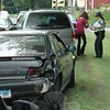 Police, Newtown Volunteer Ambulance Corps members, and Botsford Fire Rescue volunteer firefighters responded to a two-vehicle accident about 3:26 pm on May 24 on South Main Street. The collision, plus the ensuing investigation and cleanup, caused travel delays in the area. Police said motorist Frank Farrington, 62, of 13 Cedar Hill Road was driving a 1991 Nissan Maxima sedan southward on South Main Street and was then slowing as he was preparing to make a left turn into the driveway of a gas station at 151 South Main Street. Southbound driver Laurel Ann Ireland, 24, of Monroe, who was driving a commercial 1999 Ford Windstar minivan, attempted to pass the Nissan on the right, but struck the rear end of the Nissan. Ambulance staffers treated Farrington at the scene for a minor leg injury. Ireland received an infraction for passing on the right, according to police.  (Gorosko photo)