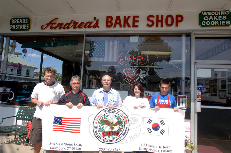 Promoting this year's fourth annual Porco's Karate Academy Donut Dash are academy instructors Keith Baxter and Nancy Gilbert, left, Amelia Schwartz, second from right, Andrea's Bake Shop owner Tony Posca, center, and employee Carson Leon-Gambetta, right. This year's dash is on June 25. Registration opens at 8:30 am at Porco's Academy at 113 Church Hill Road. The race begins at 9:30 am.  (Bobowick photo)
