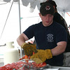 "Sandy Hook Firefighter Brian Cullinan.  (Hicks photo) NOTE: additional photos from LobterFest can be found in their own photo gallery, found here: <a href=""http://photos.newtownbee.com/Events/24th-Annual-Sandy-Hook-Lobster/17597124_2qVGdM#1340648801_zvgNTZN"">http://photos.newtownbee.com/Events/24th-Annual-Sandy-Hook-Lobster/17597124_2qVGdM#1340648801_zvgNTZN</a>"