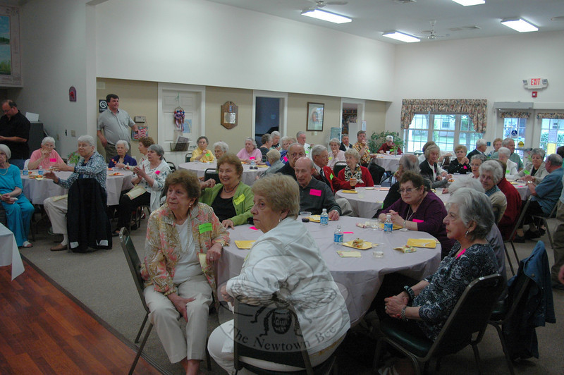Nearly 80 family members, friends, and Nunnawauk senior housing residents turned out Sunday, June 12, as the board of Newtown Housing for the Elderly hosted a surprise sendoff to honor outgoing executive director Frank DeLucia.  (Voket photo)
