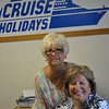 Lynn Strawson, left, and Tinker Hickey are owners of the Cruise Holidays franchise in New Milford. Business is good for the rare storefront travel agency, say the women, due to the personalized service, insight, and trustworthiness they bring to clients that is not possible through online bookings. Cruises of all kinds are the specialty at Cruise Holidays, but land packages can also be booked through the company.  (Crevier photo)