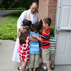 Pastor Wismar is surrounded by six of his 12 grandchildren following the worship service at Christ the King on Sunday, June 12.  (Hicks photo)