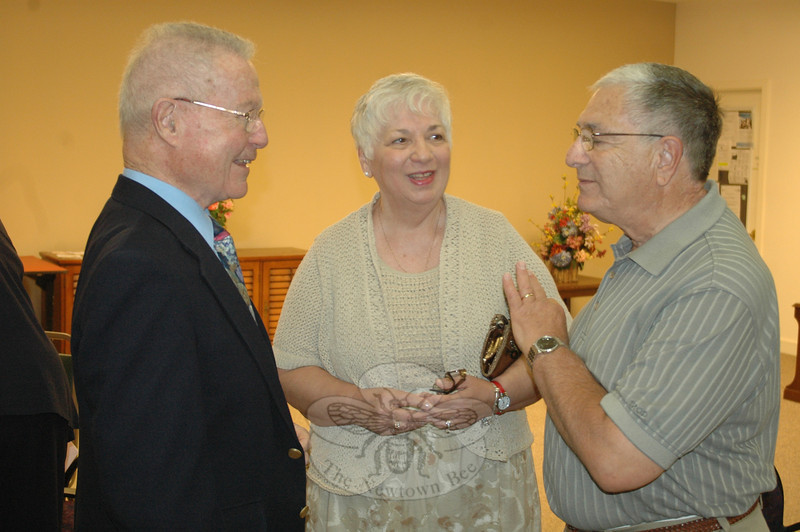 Nearly 80 family members, friends, and Nunnawauk senior housing residents turned out Sunday, June 12, as the board of Newtown Housing for the Elderly hosted a surprise sendoff to honor outgoing executive director Frank DeLucia (right). Mr DeLucia and his wife Miriam were greeted by local officials including Selectman Will Rodgers and former First Selectman Joe Borst (left).  (Voket photo)
