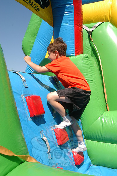 Hawley student Matthew Pereira was one of many students who climbed their way through a blown-up obstacle course Thursday, June 2, during the school's annual year-end field day event.  (Hallabeck photo)