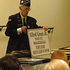 Newtown resident Alfred Green, Jr, with a sign he held during Newtown's 2010 Labor Day Parade. Mr Green spoke to Newtown High School students on June 8, during a presentation by World War II veterans and the Military Museum of Southern New England of Danbury.  (Hallabeck photo)