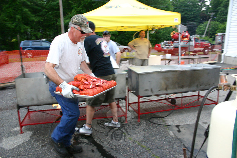"""Rich Liska heads toward the dining area with a tray of just-steamed lobsters.  (Hicks photo) NOTE: additional photos from LobterFest can be found in their own photo gallery, found here: <a href=""""http://photos.newtownbee.com/Events/24th-Annual-Sandy-Hook-Lobster/17597124_2qVGdM#1340648801_zvgNTZN"""">http://photos.newtownbee.com/Events/24th-Annual-Sandy-Hook-Lobster/17597124_2qVGdM#1340648801_zvgNTZN</a>"""