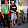 During the annual meeting on Monday, June 6, of Sandy Hook Volunteer Fire & Rescue Company, it was announced that Brad Richardson had been selected the company's 2011 Firefighter of the Year. Ken Carlson, Chuck Kilson, and Steve Stohl made the announcement during the meeting, and presented Mr Richardson with a plaque. Mr Richardson's name has also been added to a permanent plaque at the firehouse along with previous Firefighter of the Year honorees. The current president of the company, Mr Richardson, who joined Sandy Hook when he turned 16, has also served as an engineer, lieutenant, captain, treasurer, and vice president. He was named a Life Member in 2008. In the photo, from left, are Mr Stohl, Mr Kilson, Mr Richardson, and Mr Carlson.  (Hicks photo)