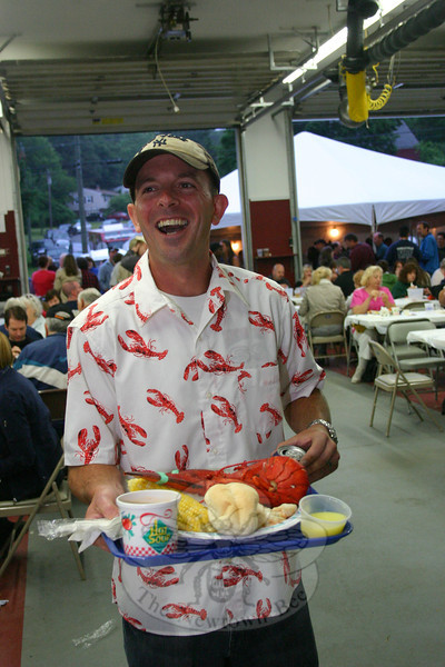 "If there were an award for Best LobsterFest Shirt, Sandy Hook resident Bill Pendergast would have won it, hands down.  (Hicks photo) NOTE: additional photos from LobterFest can be found in their own photo gallery, found here: <a href=""http://photos.newtownbee.com/Events/24th-Annual-Sandy-Hook-Lobster/17597124_2qVGdM#1340648801_zvgNTZN"">http://photos.newtownbee.com/Events/24th-Annual-Sandy-Hook-Lobster/17597124_2qVGdM#1340648801_zvgNTZN</a>"