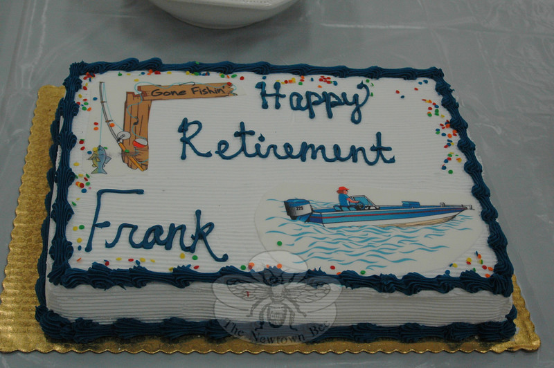 Nearly 80 family members, friends, and Nunnawauk senior housing residents turned out Sunday, June 12, as the board of Newtown Housing for the Elderly hosted a surprise sendoff to honor outgoing executive director Frank DeLucia, who, according to the images on his cake, will have plenty of time for fishing.  (Voket photo)
